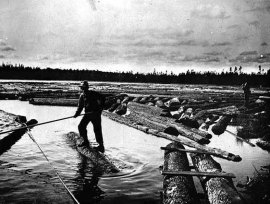 Log Drivers breaking up a logjam (circa 1890).